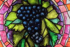Wine motif in one of the stained glass windows